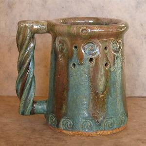 stein style puzzle mug copper green