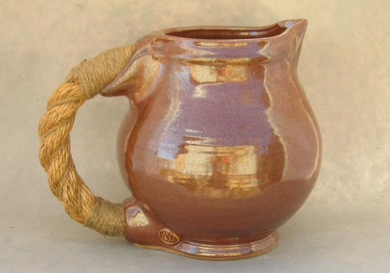 medieval inspired pitcher rustic rope handle stoneware
