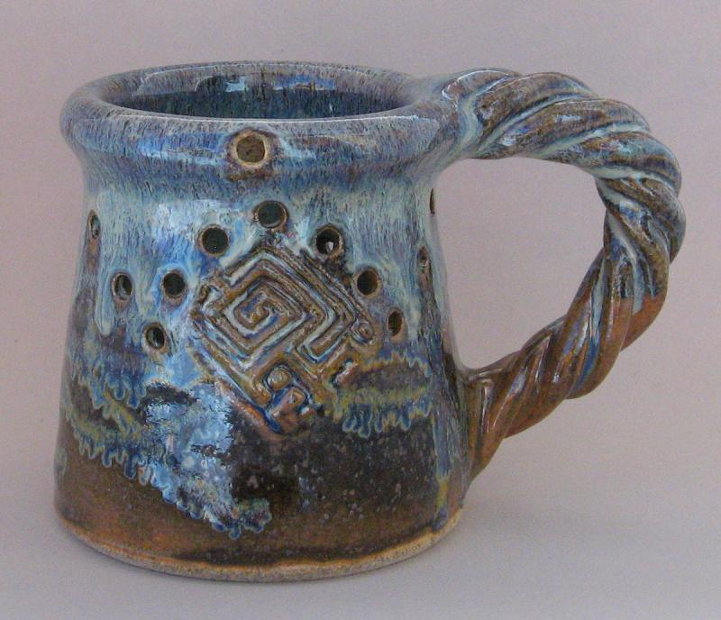 pottery puzzle mug twisted handle muddy mountain